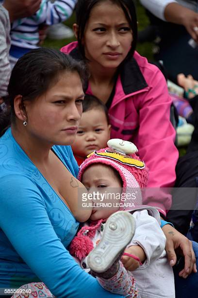 Women breastfeed their babies during a large scale breastfeeding event at a park in Bogota on August 3 2016 Hundreds of mothers simultaneously...
