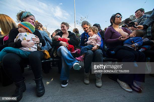 Women breastfeed their children during a demonstration at a square in San Isidro on the outskirts of Buenos Aires on July 23 2016 The demonstration...