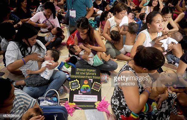 Women breastfeed their children in suburban Manila on August 1 to celebrate National Breastfeeding Awareness Month The Philippines observes...