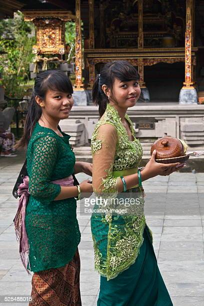 Women Bring Offering To The Pura Tirta Empul Temple Complex During The Galungan Festival Tampaksiring Bali Indonesia