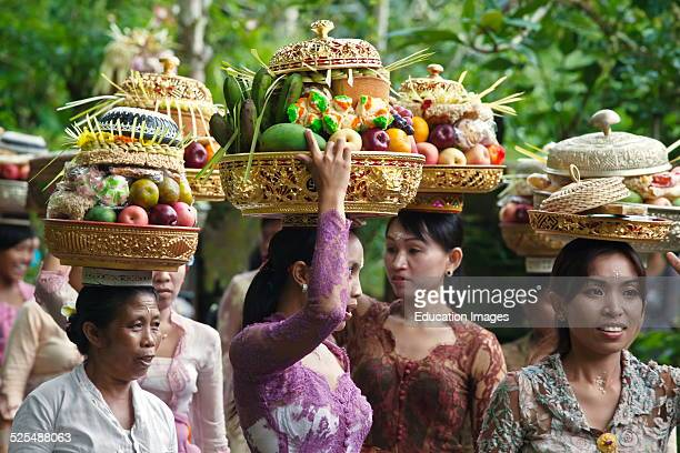 Women Bring Offerings Of Frut Flowers And Pastries To The Pura Tirta Empul Temple Complex During The Galungan Festival Tampaksiring Bali Indonesia