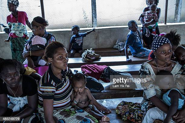 Women bring their children to see doctor at Gondama Referral Centre on March 7 2014 in Bo District Sierra Leone Sierra Leone has a high child...