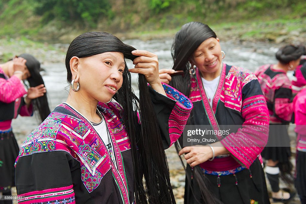 Women brush and style long hair in Longji village, China. : Stock Photo