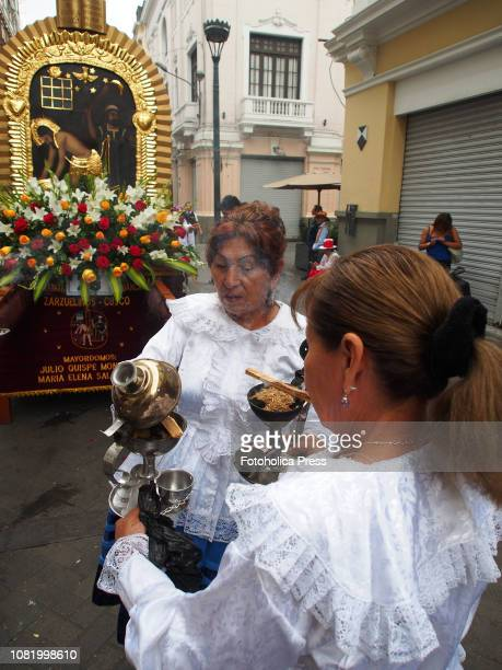 Women burning incense when hundreds of Quechuaspeaking Indigenous people devotees of San Sebastian carry on a religious procession to the cathedral...
