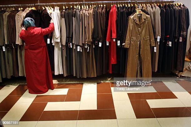 women buy cloths at Tekbir sales point in their main building on October 03 2007 in Istanbul Turkey Tekbir is the largest design and fashion company...