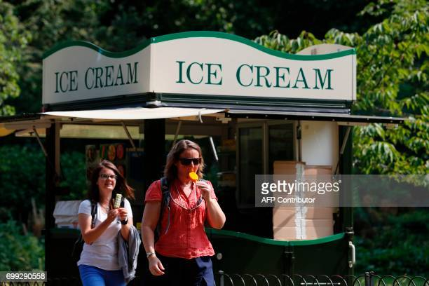 Women buy ice cream in St James's Park in central London on June 21 2017 Europe sizzled under a continentwide heatwave on June 21 with London bracing...