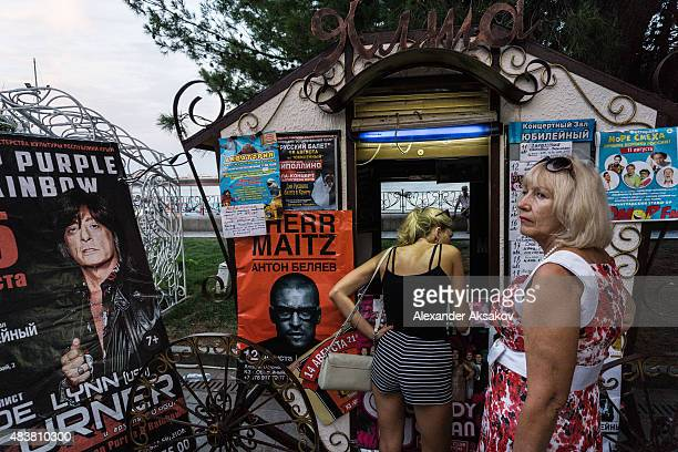 Women buy tickets for concerts on August 10 2015 in Yalta Crimea Russian President Vladimir Putin signed a bill in March 2014 to annexe the Crimean...