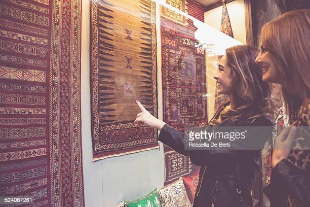 Women Buying Carpets
