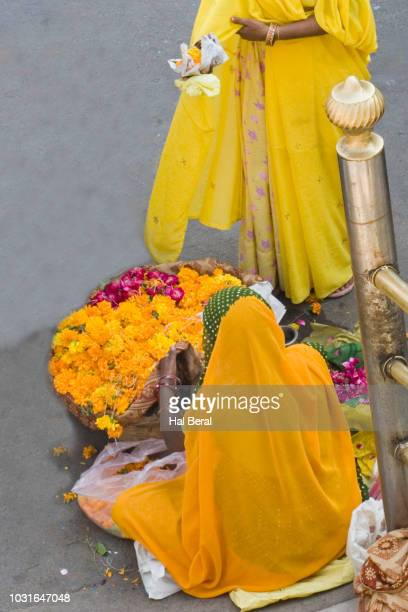 women buying flowers from street vendor for temple offering - for stock pictures, royalty-free photos & images