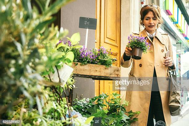 women buying flowers in the streets of Paris, France