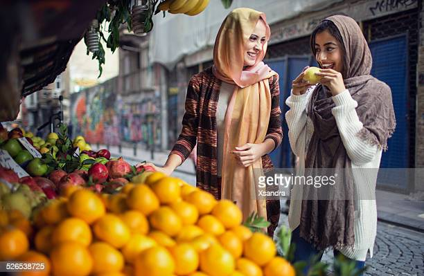 women buying fruits from the street vendor - turkey middle east stock pictures, royalty-free photos & images
