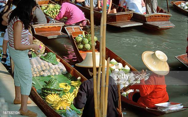 Women buying fruits on the floating market