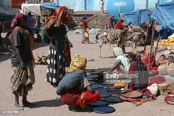 Women buying injera cooking plates, Harar, Ethiopia