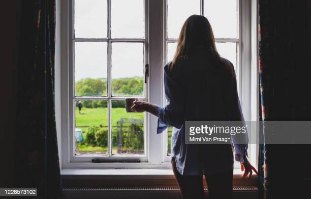 women by the window - silhouette stock pictures, royalty-free photos & images
