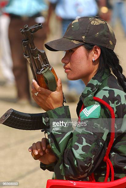 Women cadre of the militant Karbi Longri National Liberation Front Kave Rongpipi holds a gun during an armslaying ceremony at Diphu in the Karbi...
