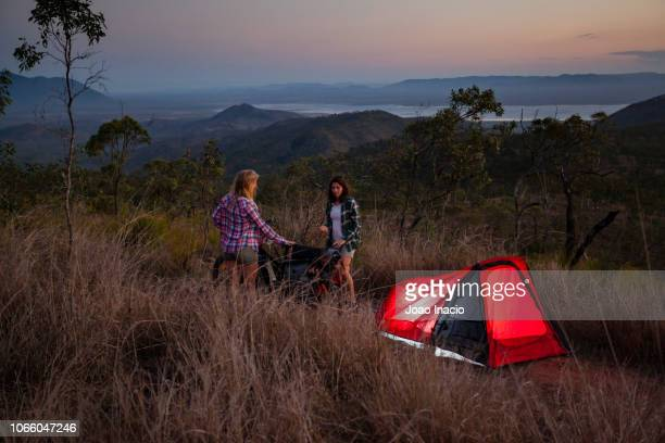 women camping in remote australia - townsville queensland stock pictures, royalty-free photos & images