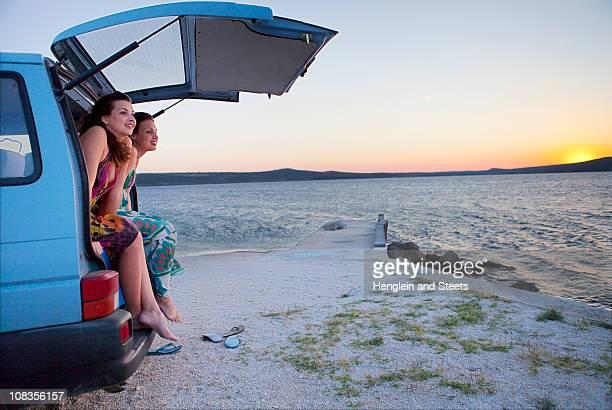 Women camping in van at the beach