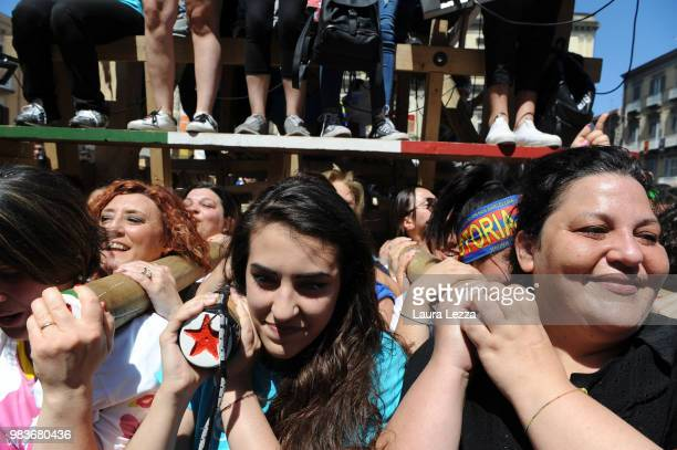 Women carry a 25metre tall wood and papiermache statue called 'giglio' during the annual Festa dei Gigli on June 25 2018 in Nola Italy When St...