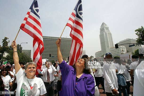 Women carry American peace flags during a rally on what is dubbed a Day Without Immigrants or the Great American Boycott day on May 1 2006 in Los...