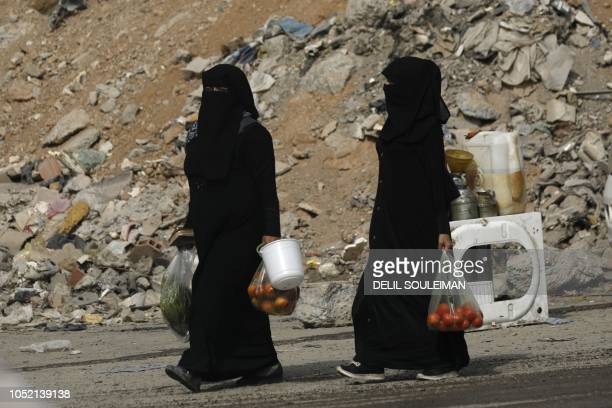 Women carry food bags as they return from the market in the northern Syrian city of Raqa on October 14 2018 Once the de facto Syrian capital of the...