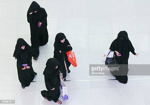 Women carry shopping bags in the Dubai Mall which is owned by Emaar Properties PJSC in Dubai United Arab Emirates on Sunday July 12 2009 The mall...