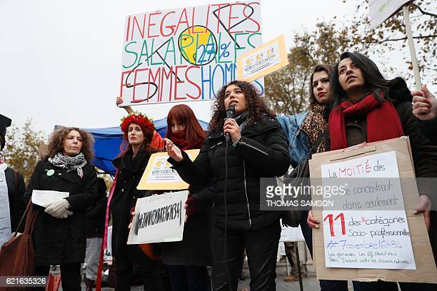 Women carry signs and placards during a demonstration for equal pay between men and women on November 7 at Place de la Republique in Paris Some 200...
