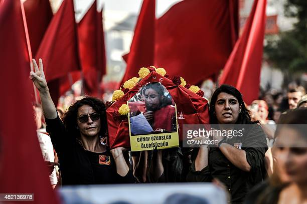Women carry the coffin of leftwing militant Gunay Ozarslan during her funeral on July 27 in Istanbul's Gazi district after she was killed during...