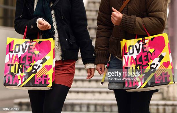 Women carry Valentine's Day gift bags on February 12 2012 in Kobe Japan Shops are putting out candy and other traditional gifts for the upcoming...