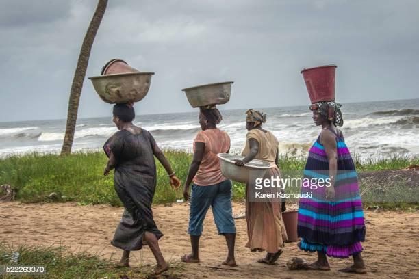 Women Carrying Baskets in Ghana
