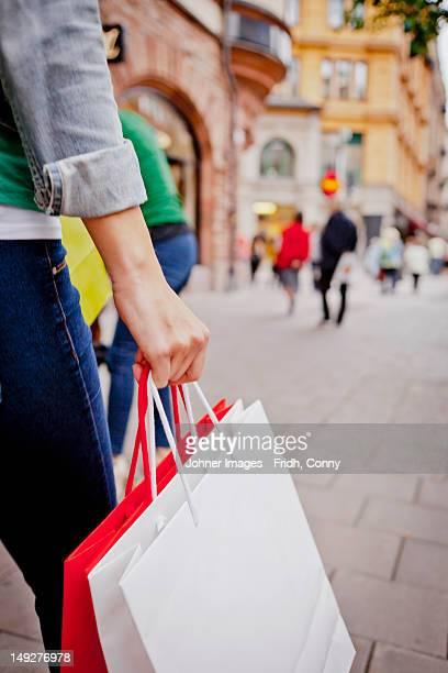 Women carrying shopping bags in street