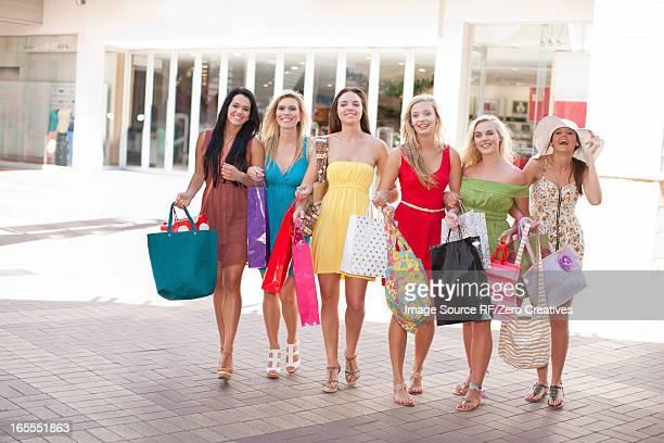 Women carrying shopping bags outdoors