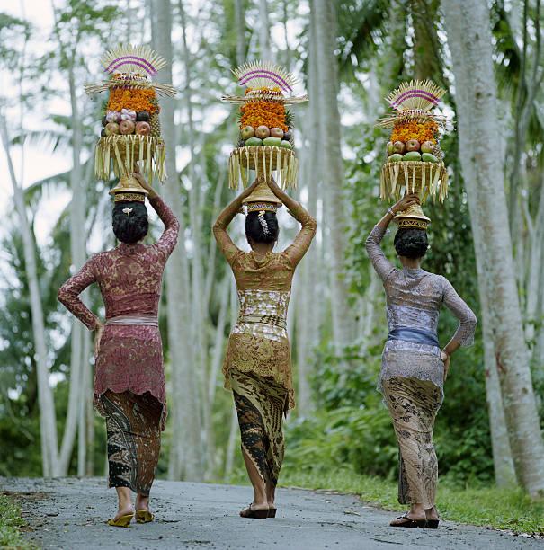 women carrying temple offerings