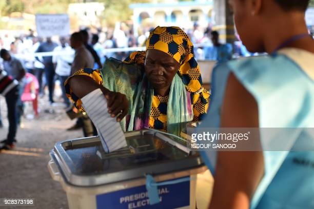 TOPSHOT A women cast her ballot as part of the general elections on March 7 2018 at a polling station in Freetown More than 31 million voters are...