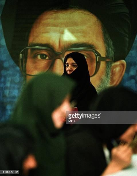 TEHRAN IRAN Women cast their ballots under a poster of Supreme Leader Ayatoolah Ali Khamenei in Iran's parliamentary elections on Friday February 20...