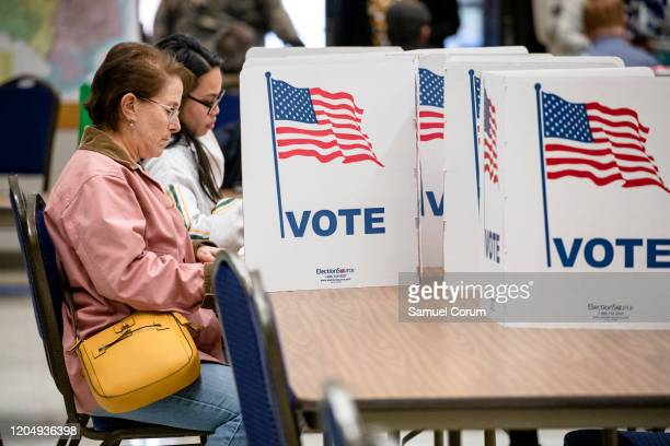 Women cast their votes in the Democratic presidential primary election at a polling location in Annandale Fire Station on Super Tuesday March 3 2020...