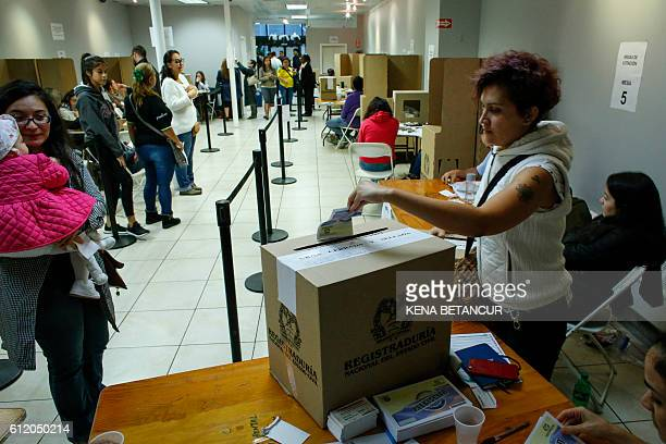 A women casts her vote at a polling station inside the Colombia Consulate in New York on October 2 2016 Colombians are voting for the referendum on...