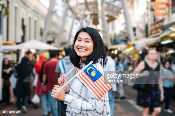 women celebrate malaysia independence day - malaysian culture stock pictures, royalty-free photos & images