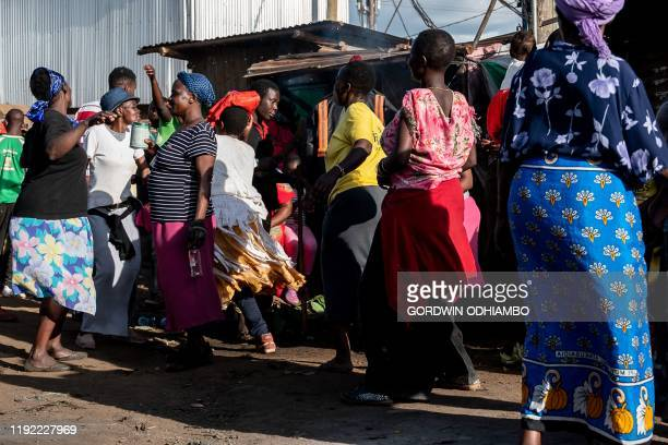 Women celebrate the circumcision of 18yearold Isaac Namolo from Gisu tribe on a street at Kibera slum in Nairobi Kenya on January 6 2020