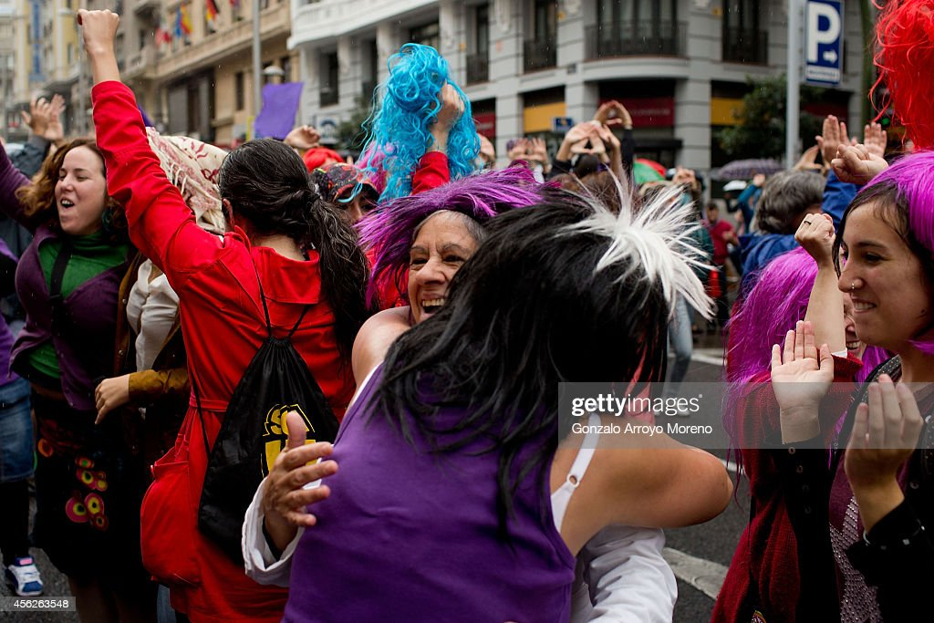 Women celebrate the Spanish govermment new abortion law withdrawal and the resignation of Justice Minister Alberto Ruiz-Gallardon during a demonstration supporting reproductive rights for women on September 28, 2014 in Madrid, Spain. During an international day supporting the decriminalization of abortion, thousands of people have celebrated the Spanish government's new abortion law withdrawal and the resignation of Justice Minister Alberto Ruiz-Gallardon. The protesters are also against Spanish government intentions to restrict the reproductive rights of female teenagers.