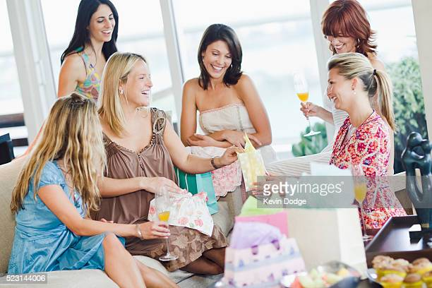 women celebrating at baby shower - baby shower stock pictures, royalty-free photos & images