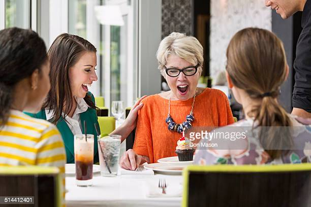 Women celebrating birthday in restaurant