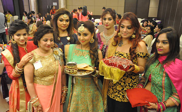 Women celebrating with great enthusiasm on the occasion of Karva Chauth festival on October 19 2016 in Amritsar India Karva Chauth is a oneday...