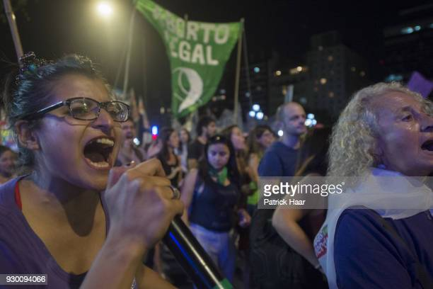 Women chant demanding legal abortion during a mass demonstration as part of International Women's Day strike in demand for women's rights and gender...