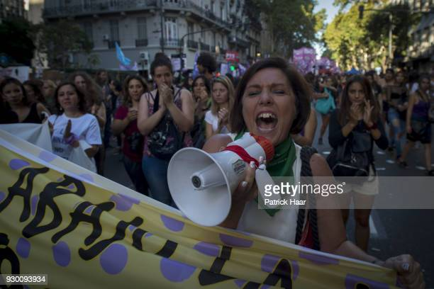 Women chant during a mass demonstration as part of International Women's Day strike in demand for women's rights and gender equality on March 08 in...