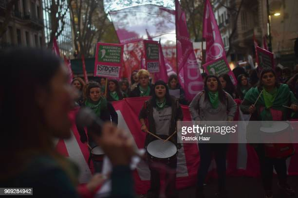Women chant during a protest as part of the 'Not One Less' movement demanding legal abortion on June 04 2018 in Buenos Aires Argentina
