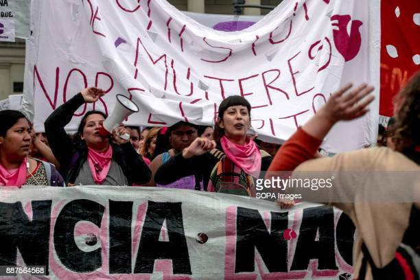 Women chant slogans and sing songs during the protest Marching from the nation's iconic Congreso buildings to Plaza De Mayo these women are...
