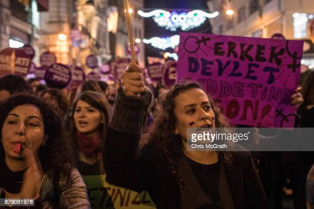 Women chant slogans and wave signs as they march down Istanbul's famous Istiklal street in support of International Day for the Elimination of...