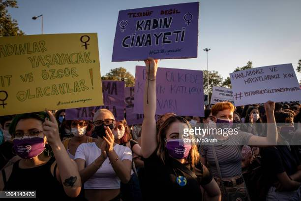 Women chant slogans and wave signs during a demonstration for the prevention of violence against women on August 5, 2020 in Istanbul, Turkey. Women's...