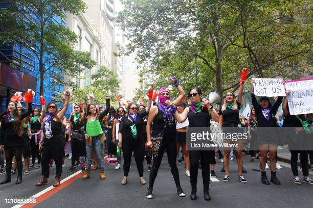 Women chant slogans as they march along Castlereagh Street in solidarity with those in South America during the Sydney International Women's Day...