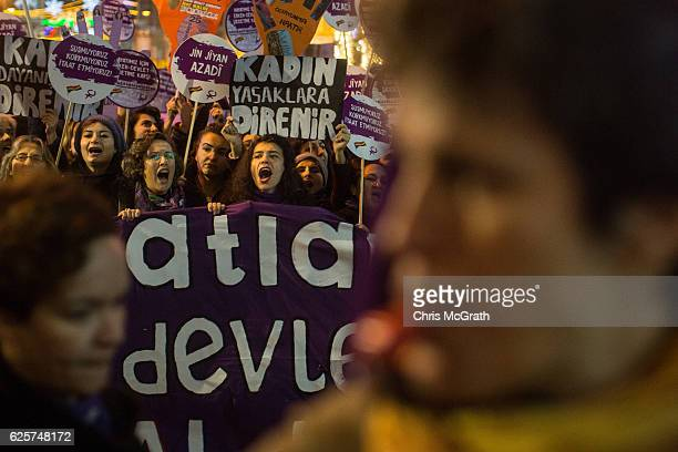 Women chant slogans as they march down Istanbul's famous Istiklal street in support of International Day for the Elimination of Violence against...